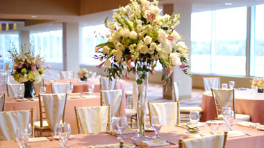 large floral centerpiece in table setting